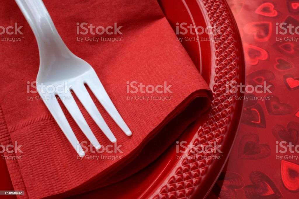paper place setting on heart background royalty-free stock photo