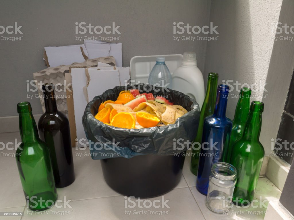 Paper, plastic, glass and organic garbage stock photo