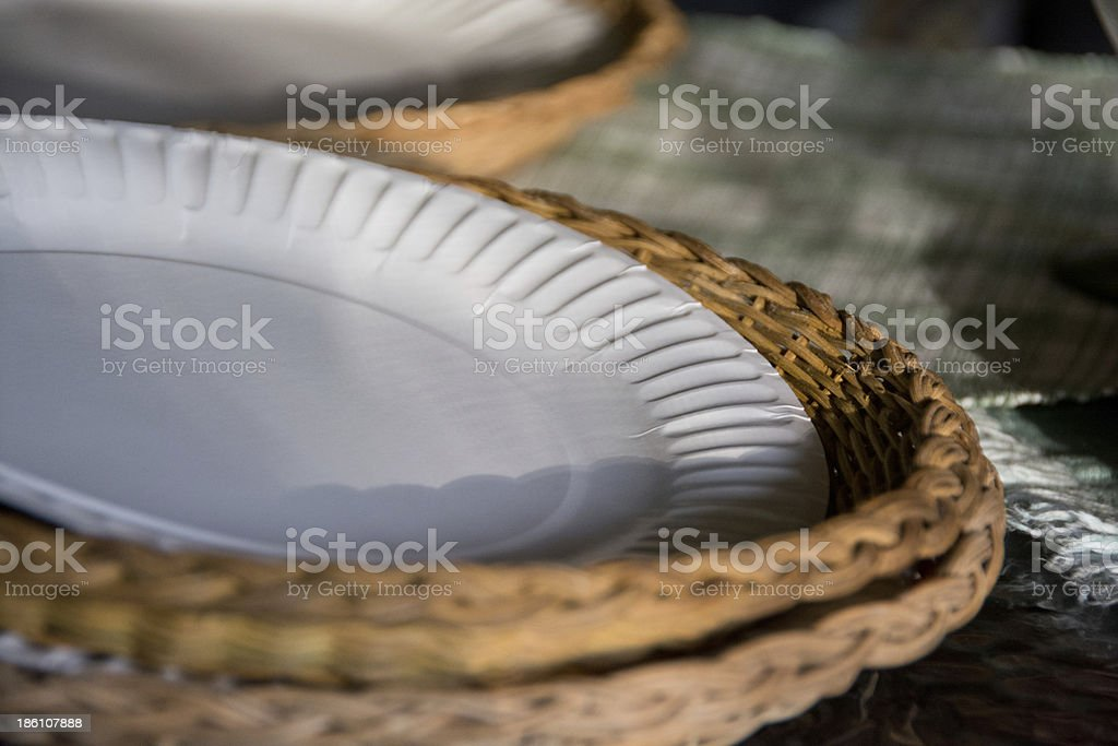 Paper plates in wicker baskets at an evening picnic stock photo