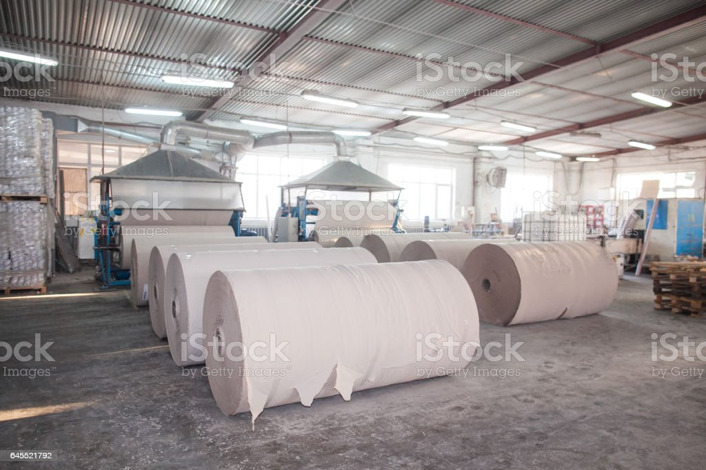 Paper production plant. Plant on production of paper towels. fragment of the industrial machine stock photo
