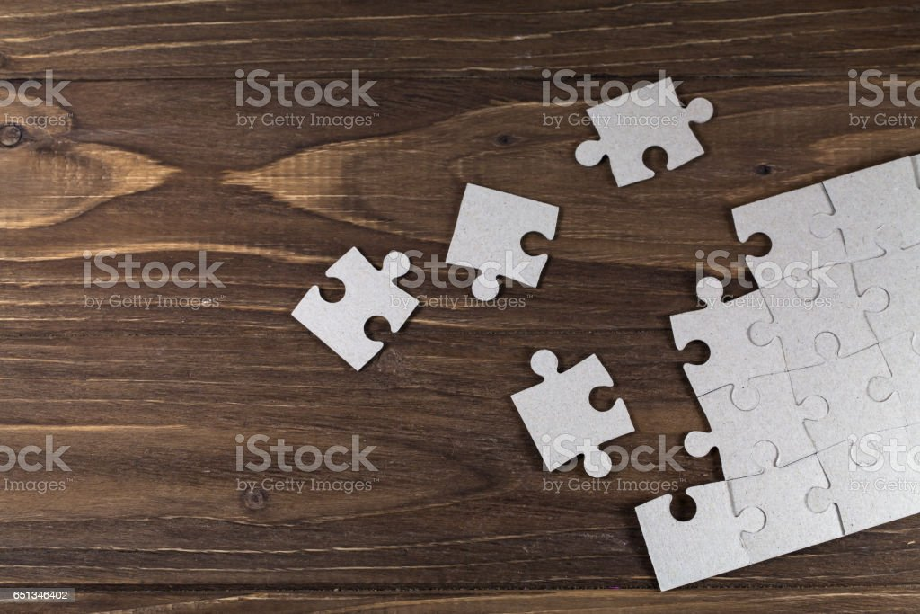 Paper puzzles on a floor stock photo