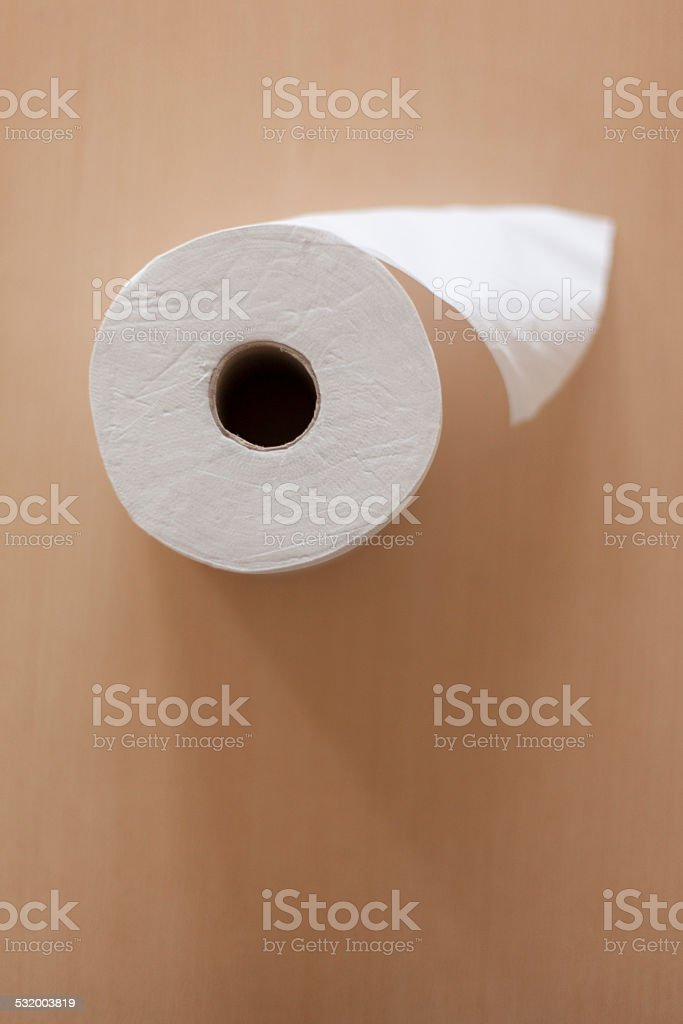 paper roll on a wooden background. stock photo