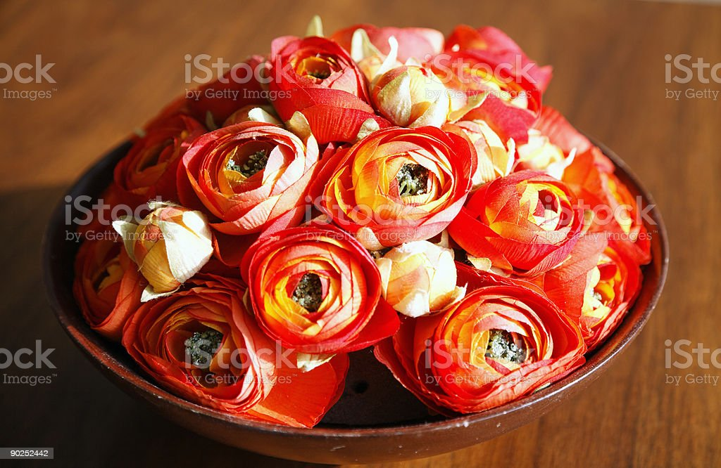 Paper Roses in a Wooden Bowl. stock photo