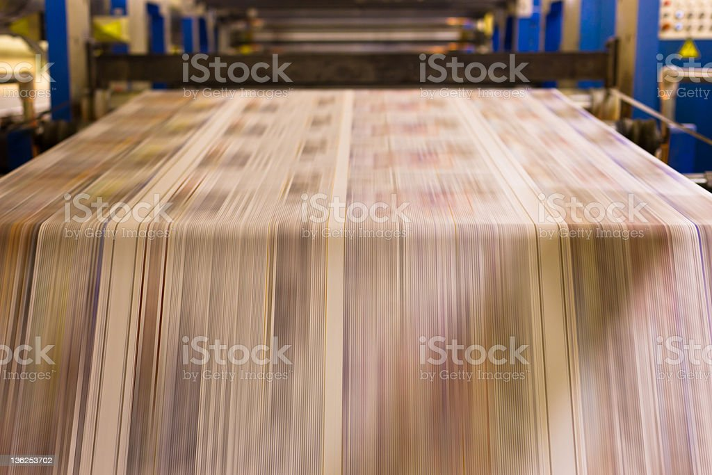 Paper running in a printing press stock photo