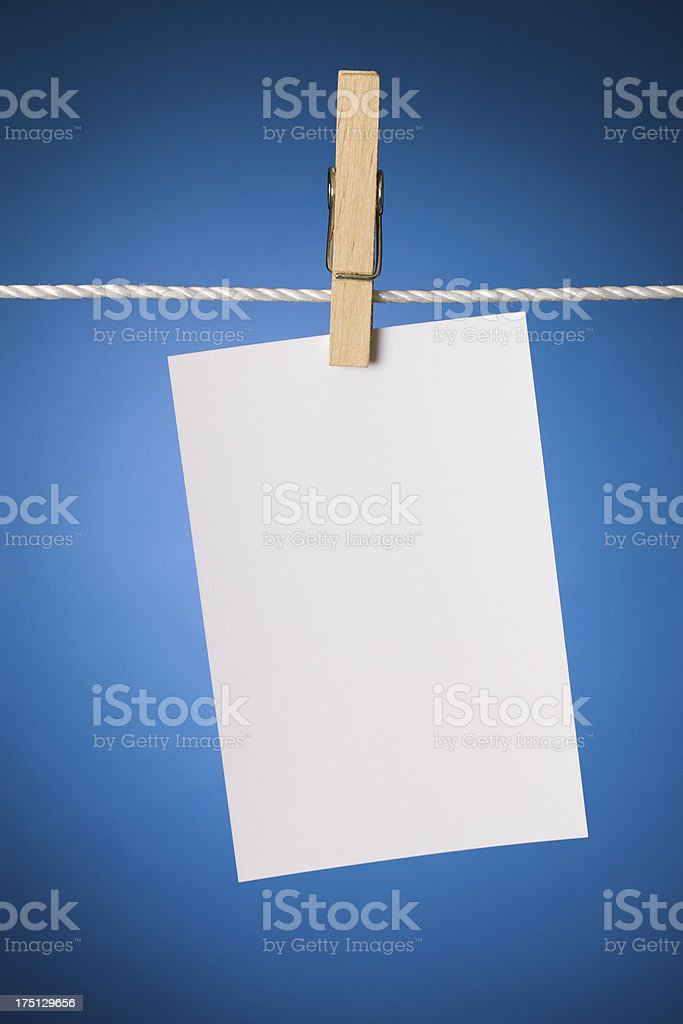Paper sheet on a clothes line stock photo