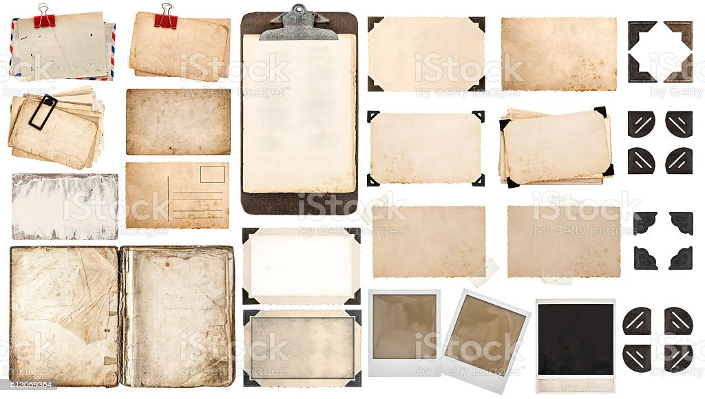 Paper sheets, book, old photo frames corners, clipboard stock photo