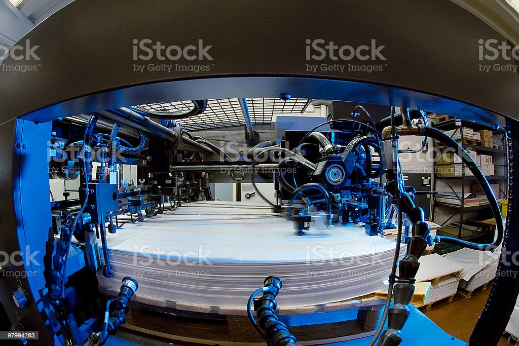Paper sheets out from the machine, fish eye, typographic industry stock photo