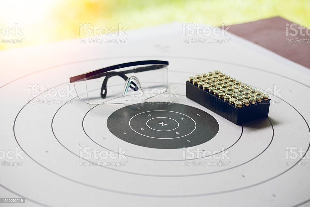 paper shooting target with bullet and protection glassess stock photo
