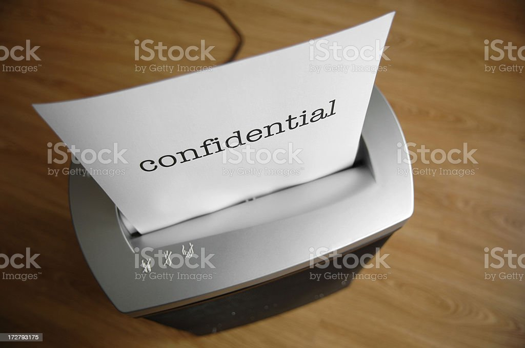 Paper shredder destroys confidential information royalty-free stock photo
