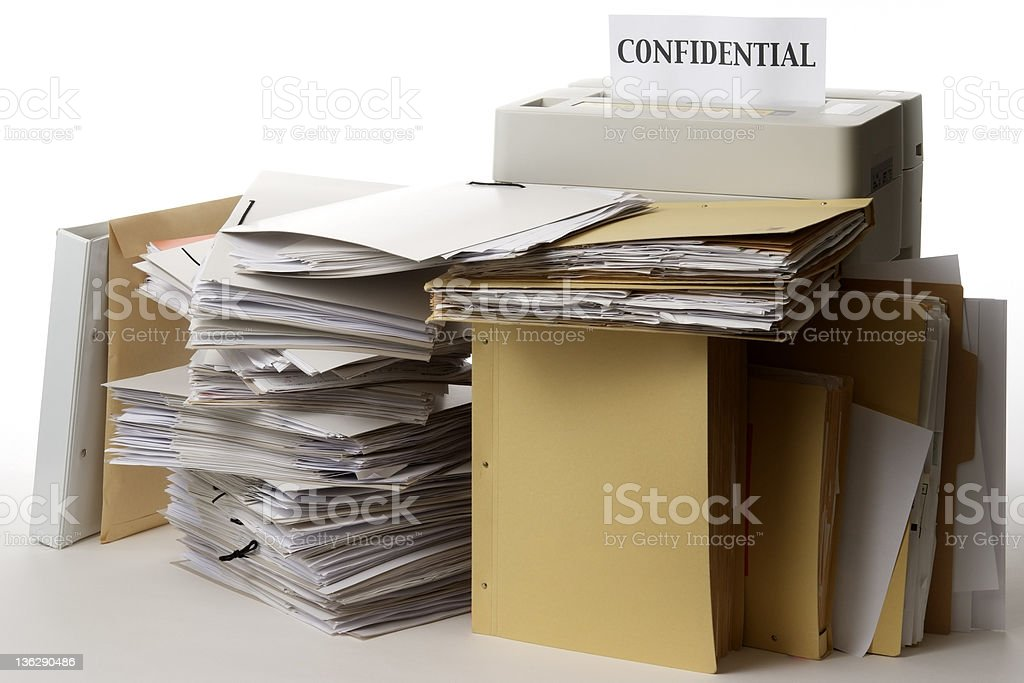 Paper shredder with confidential documents against white background royalty-free stock photo