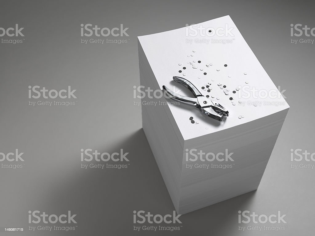 Paper Stack With Hole Punch royalty-free stock photo