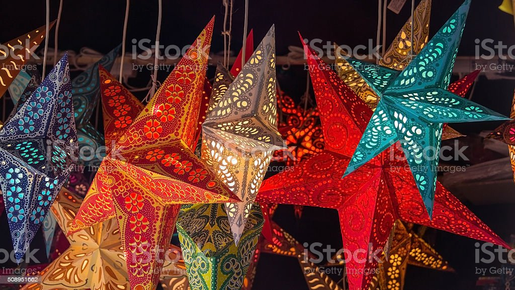 Paper star shape  laterns hanging on the market for sale stock photo