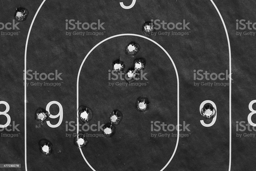 Paper target in the bullet holes stock photo