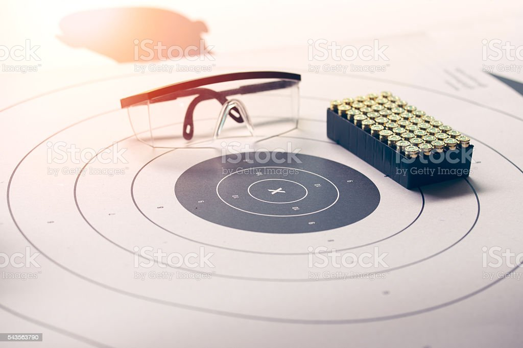 paper target with safety glasses and bullet with flare stock photo