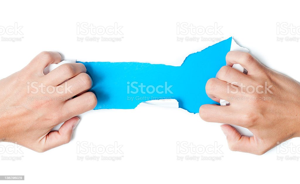 paper torn by woman hands stock photo