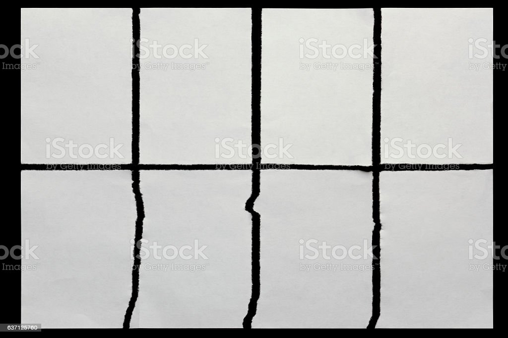 paper torn in eight pieces on a black background stock photo