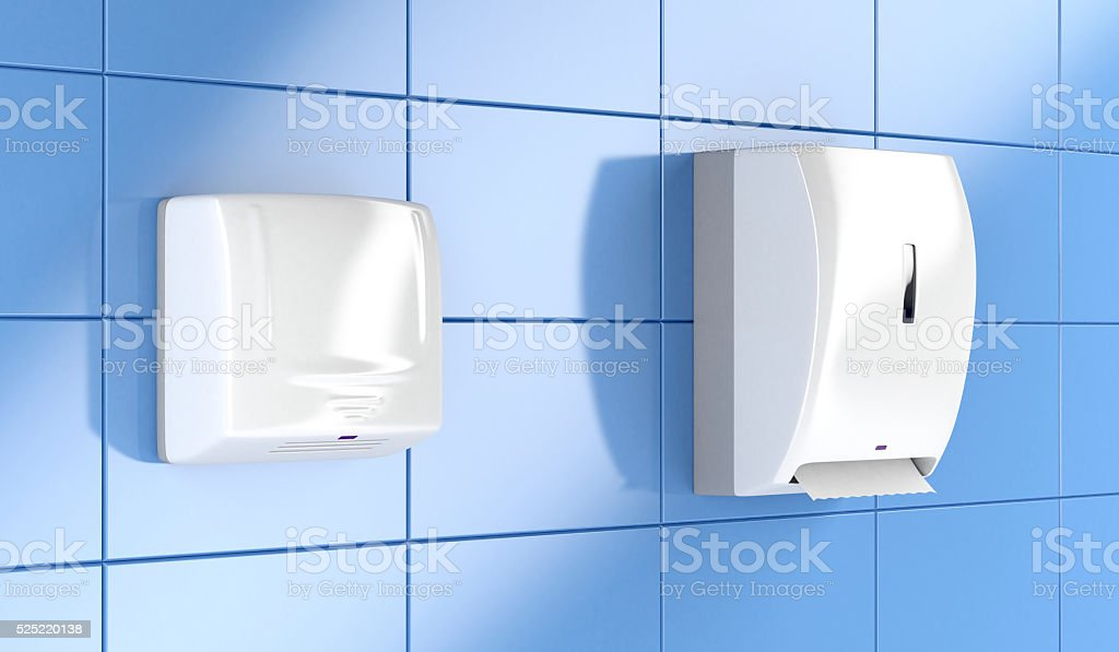 Paper towel dispenser and hand dryer stock photo