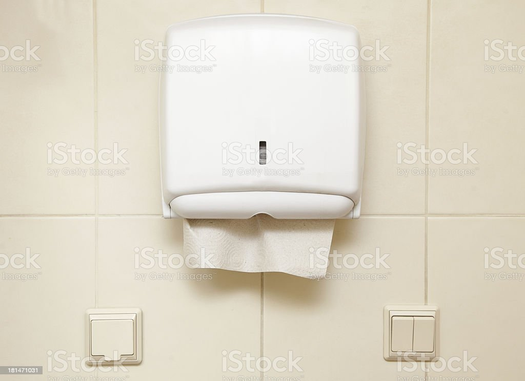 Paper towel dispenser in the bathroom stock photo