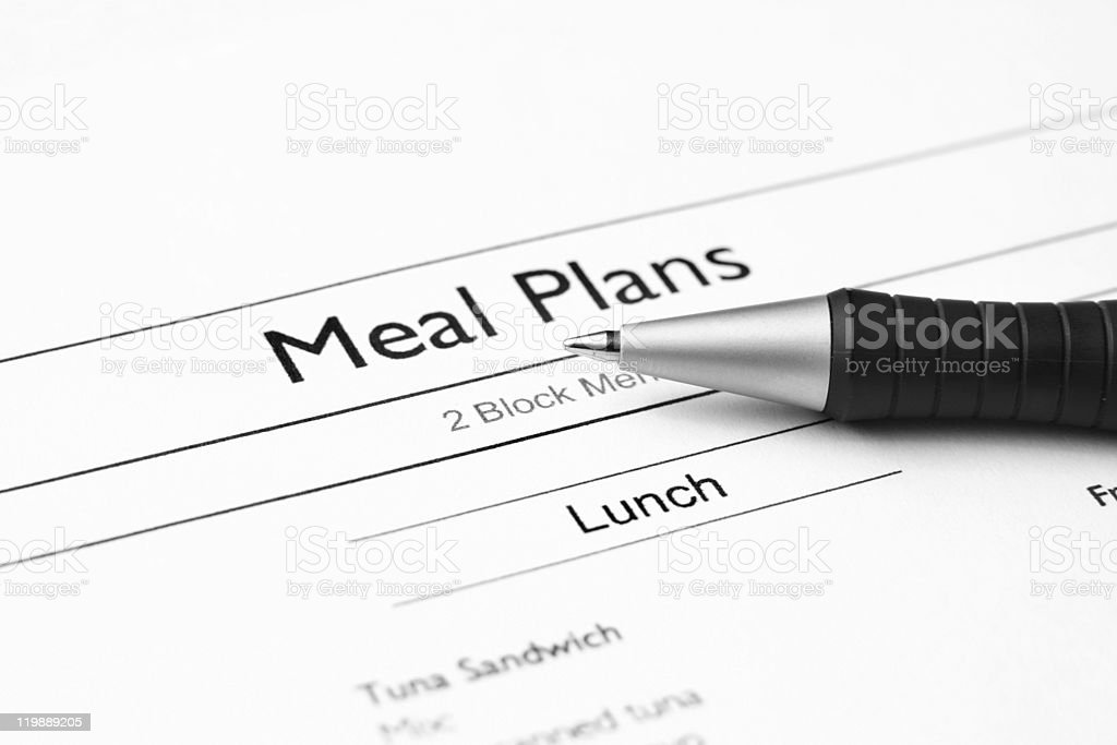 A paper with a meal plan and a pen stock photo