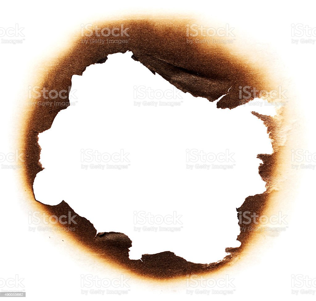 Paper with burnt hole stock photo