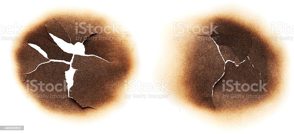 Paper with burnt holes stock photo