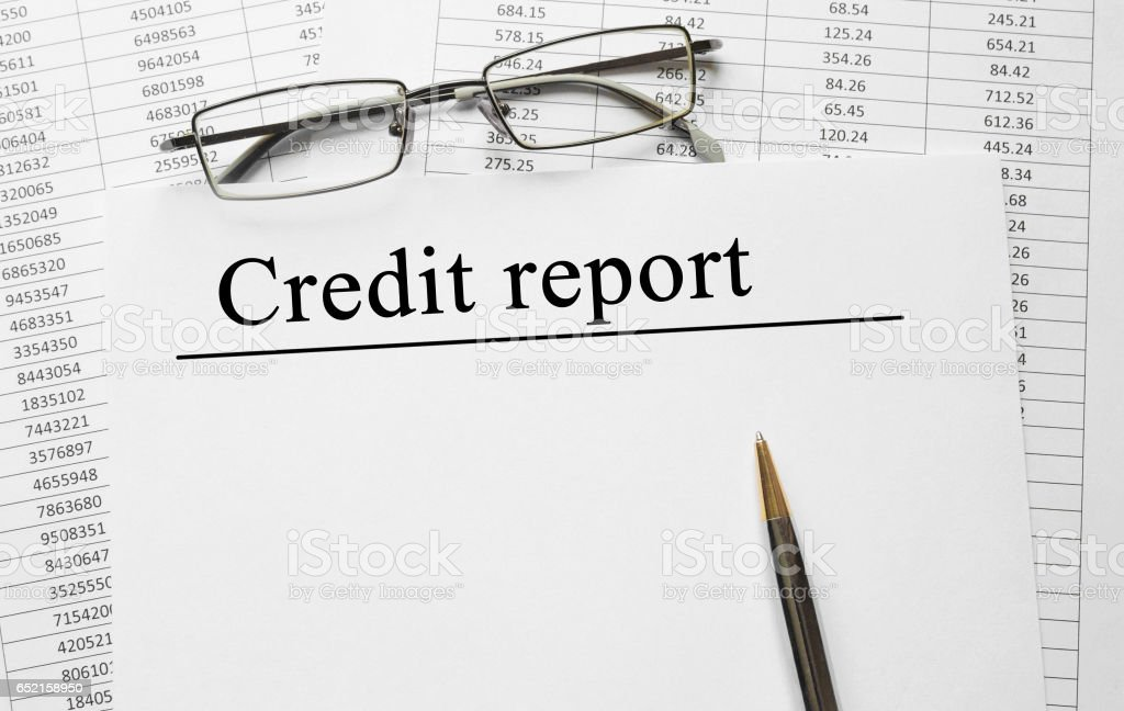 Paper with Credit report on a table stock photo