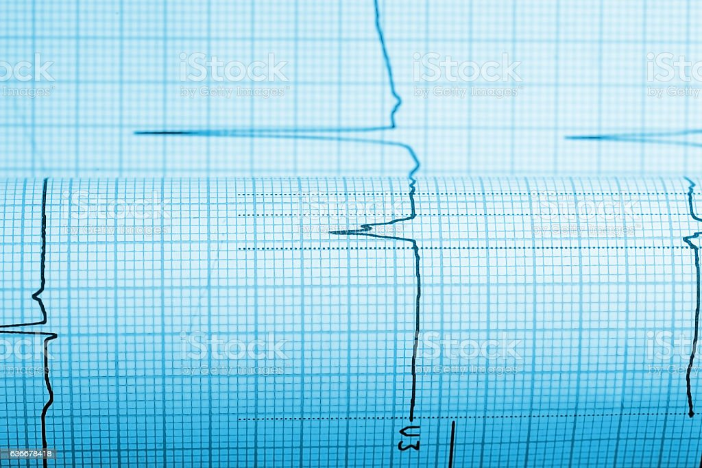 Paper with curve of a seismograph stock photo