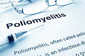 Paper with diagnosis Poliomyelitis. Polio vaccination concept.