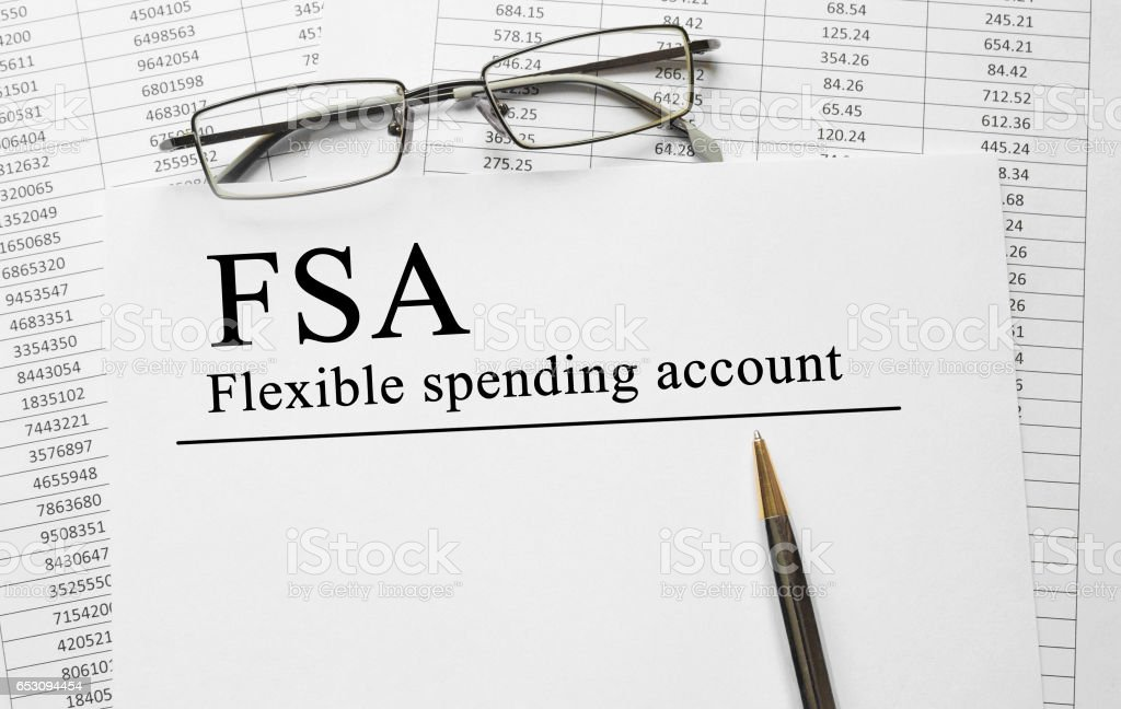 Paper with Flexible Spending Account FSA on a table stock photo