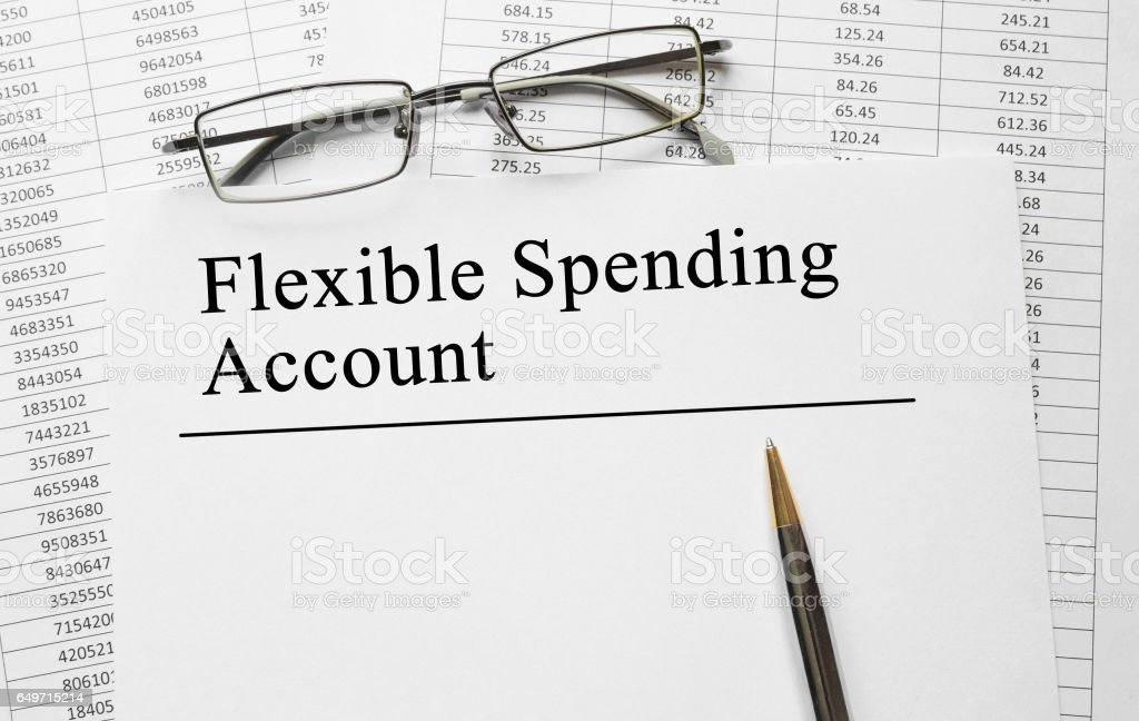 Paper with Flexible Spending Account on a table stock photo