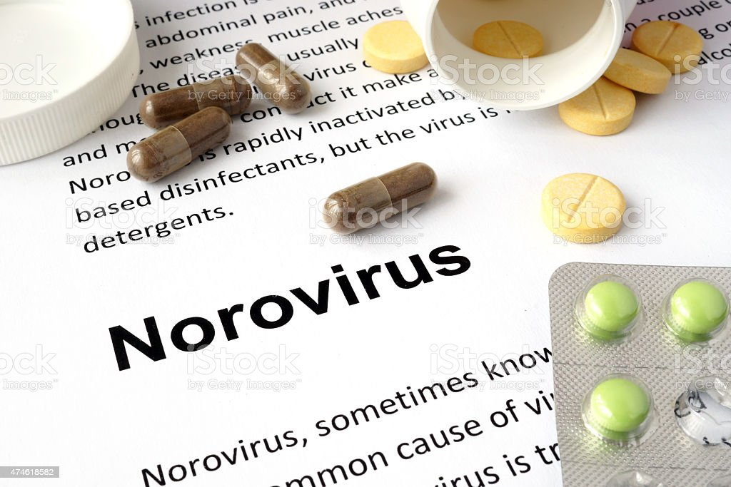 Paper with norovirus and pills. stock photo