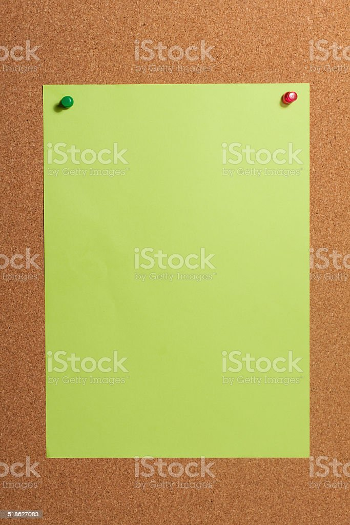 Paper with push pins on cork board. stock photo