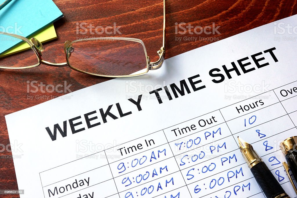 Paper with weekly time sheet on a table. stock photo