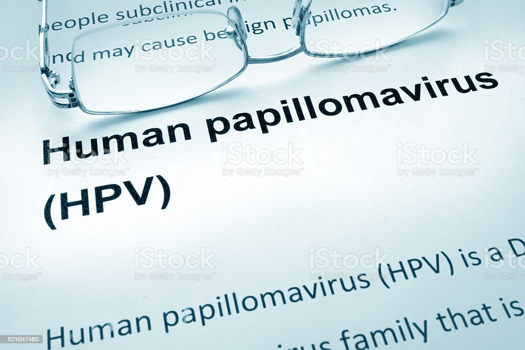 Paper with words  HPV infection and glasses. stock photo