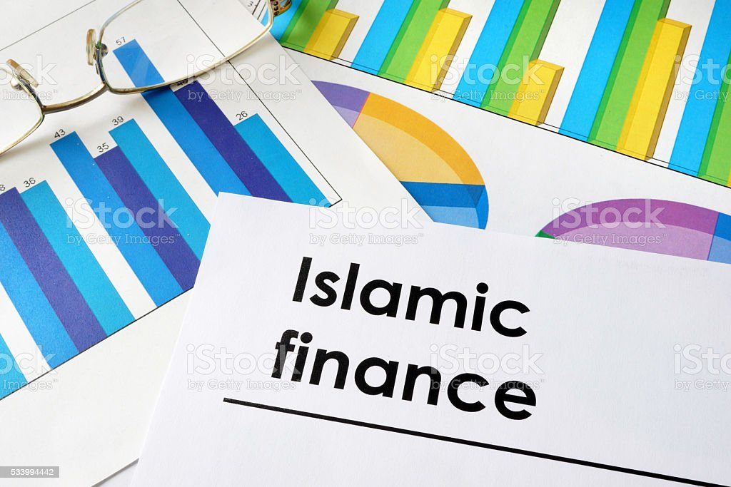 Paper with words Islamic finance and charts. stock photo