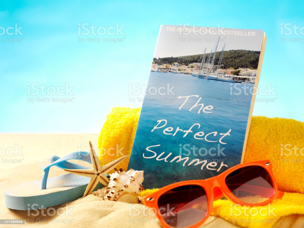 Paperback Book on the Beach with Sunglasses royalty-free stock photo