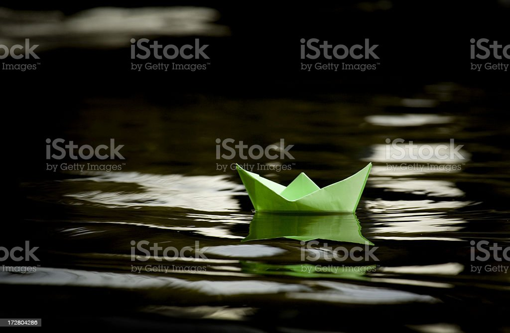 Paperboat, boat of hope stock photo