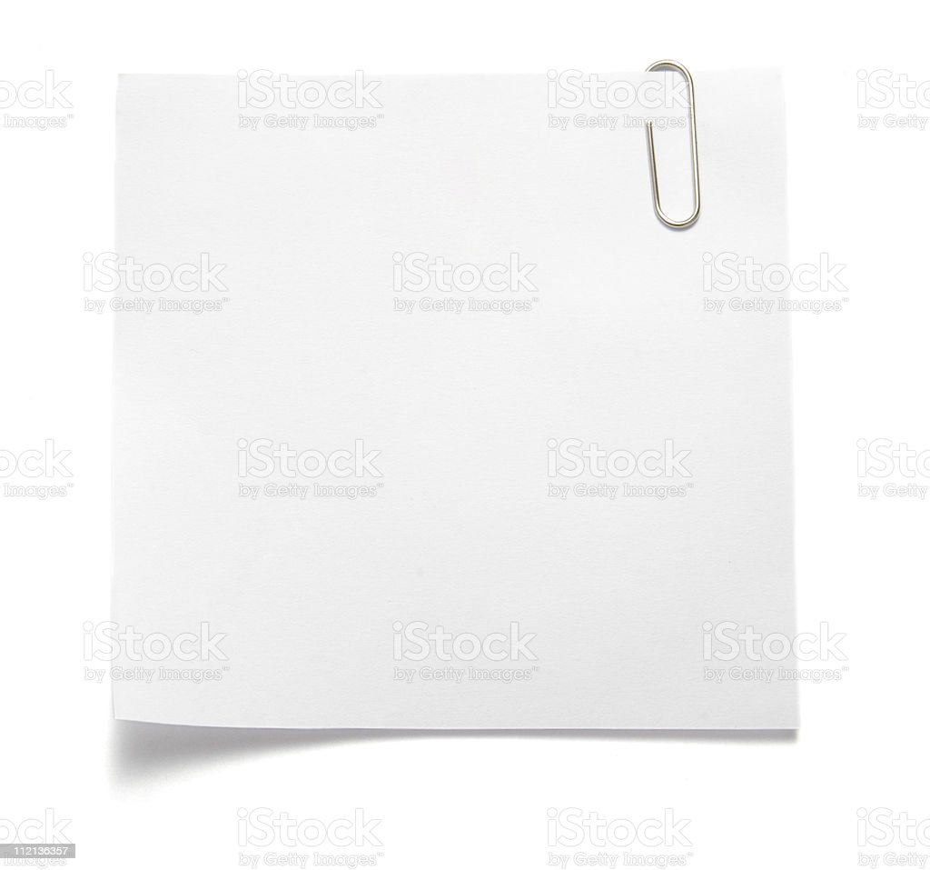 Paperclip holding note on white surface stock photo