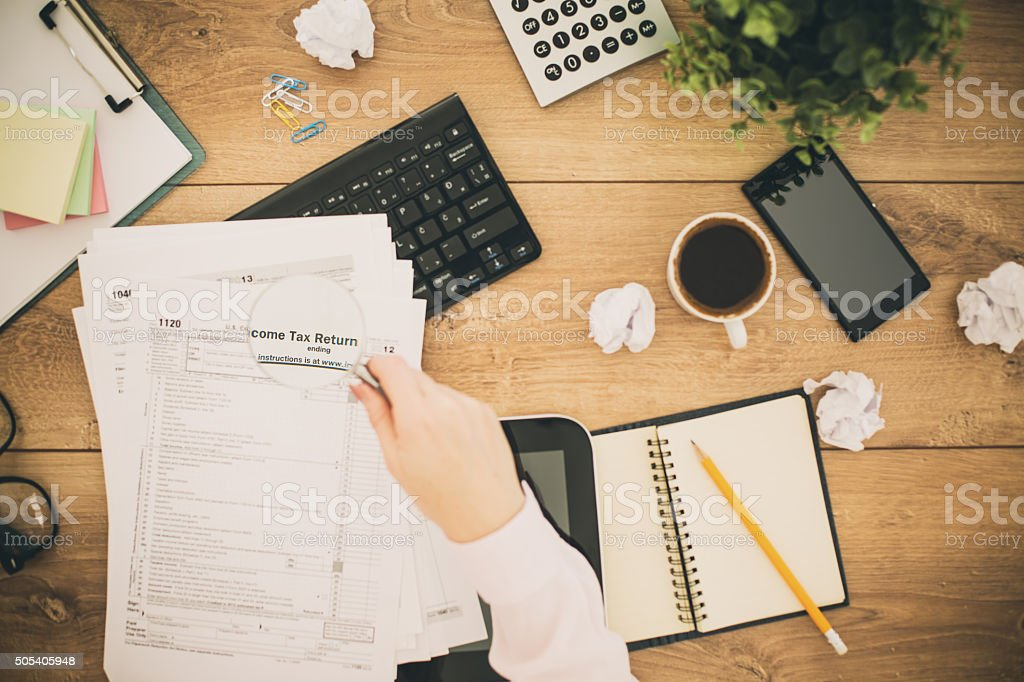 Papers and tax forms on table, directly above shot stock photo