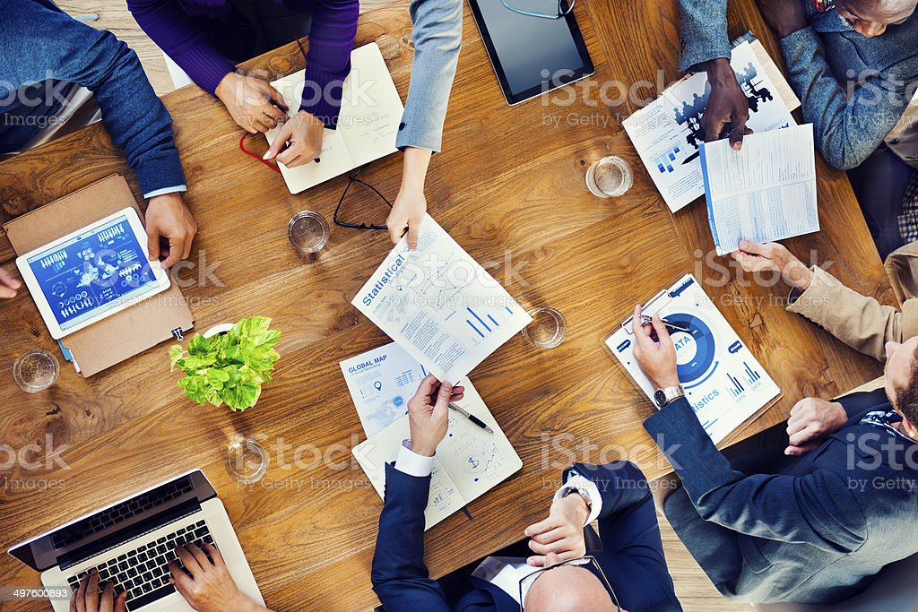Papers are passed in a business meeting stock photo