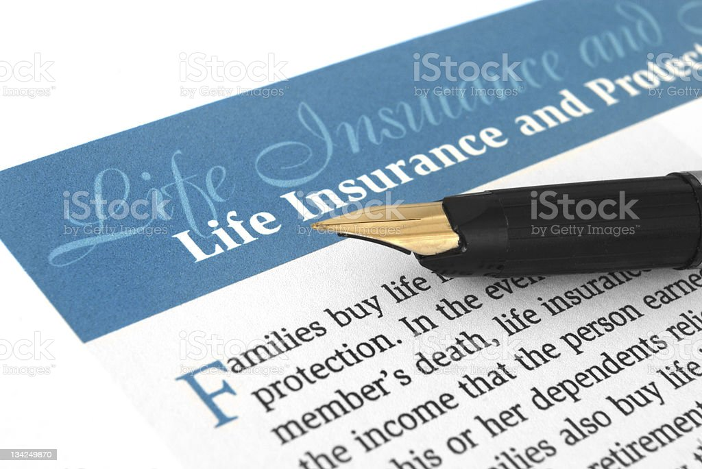 Papers for life insurance with a old fashioned pen royalty-free stock photo