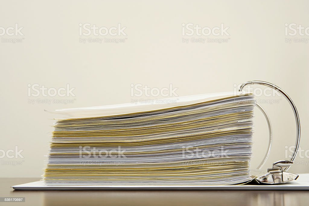 Papers in a ring binder stock photo