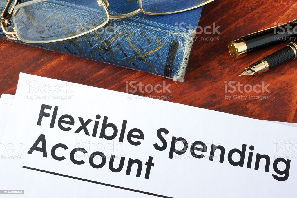 Papers with flexible spending account FSA on a table. stock photo