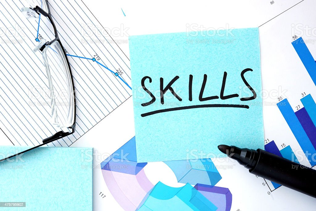 Papers with graphs, glasses and Skills concept. stock photo