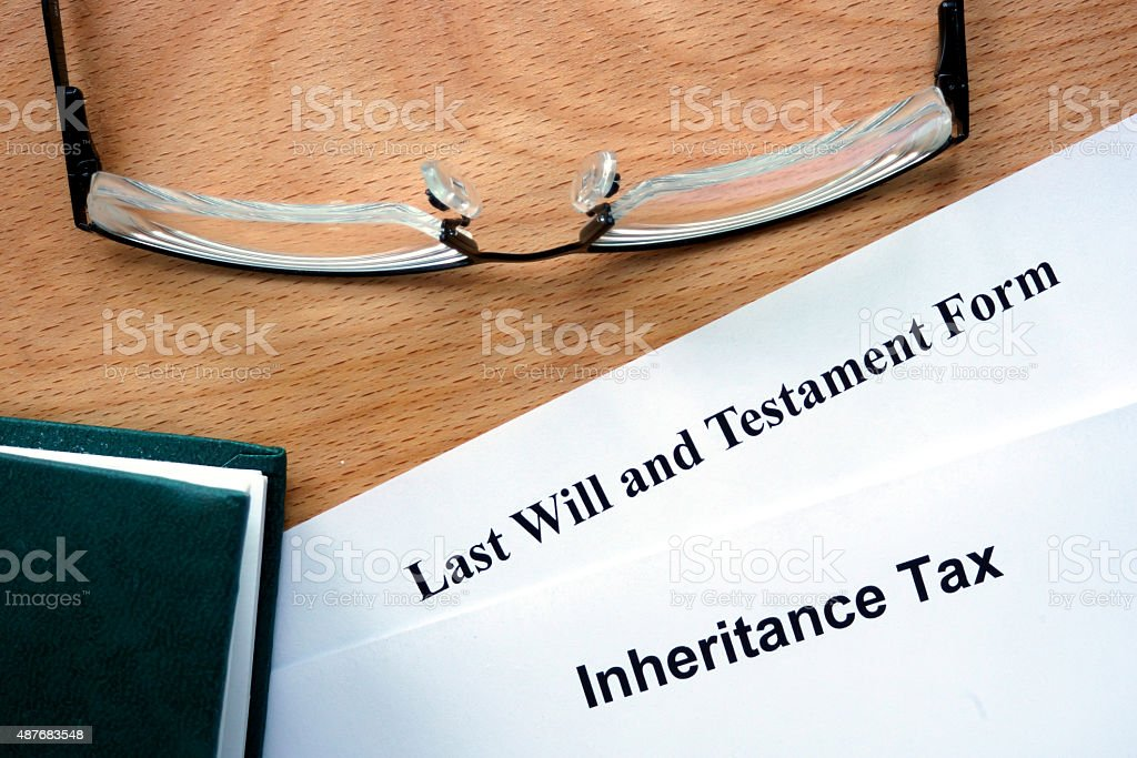 Papers with inheritance tax and testament form stock photo