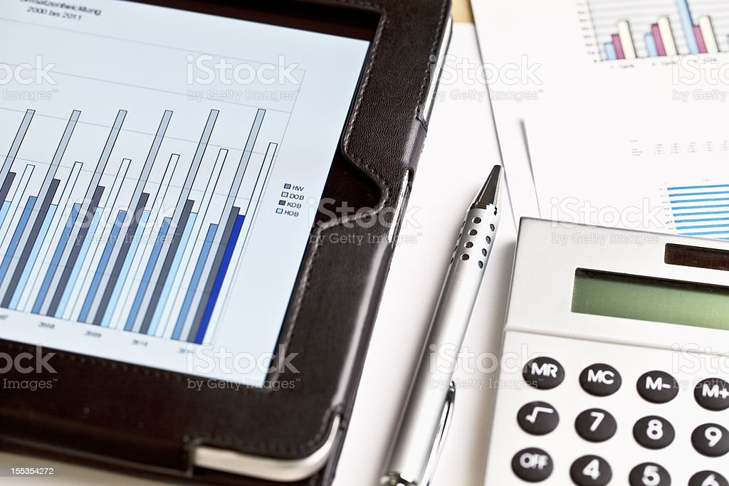 paperwork business plan calculation with digital tablet royalty-free stock photo