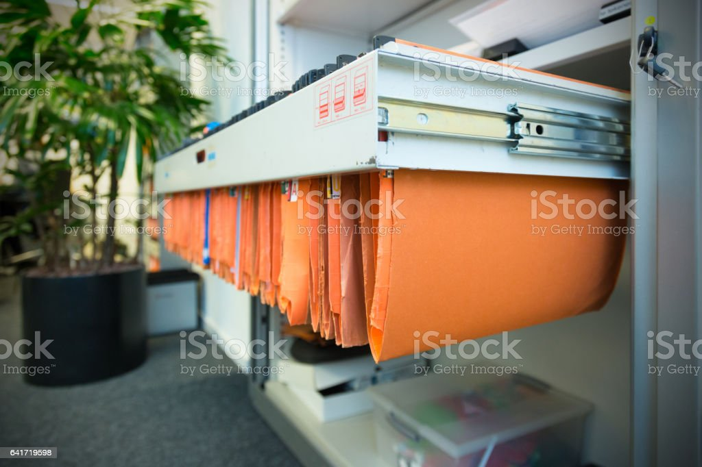 Paperwork in a filing cabinet stock photo