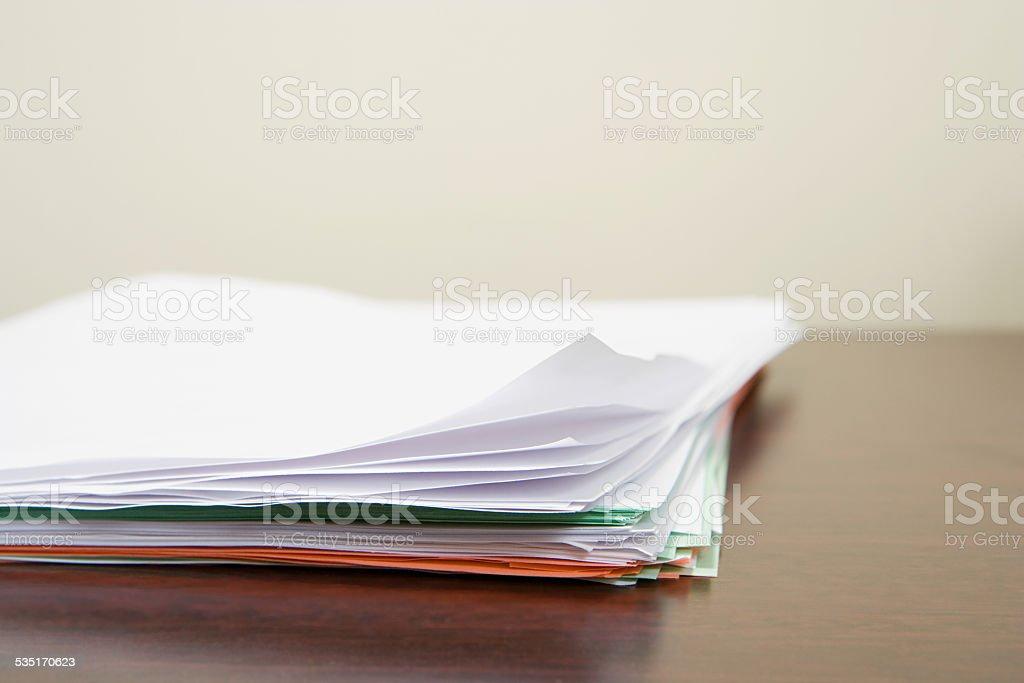 Paperwork on desk stock photo