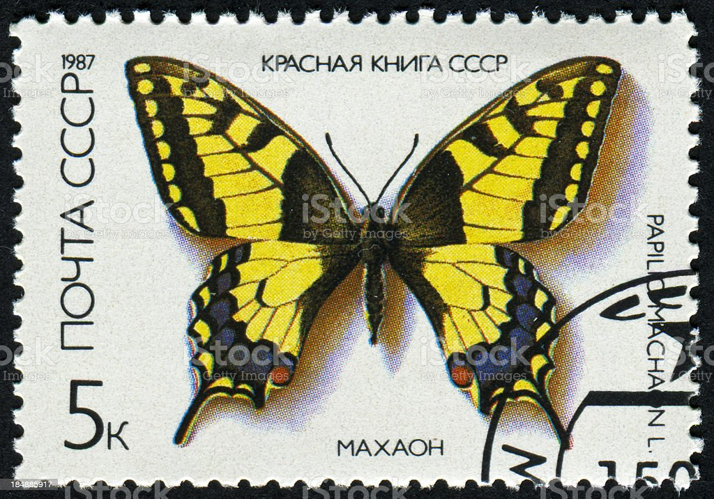 Papilio Machaon Or Swallowtail Butterfly Stamp stock photo