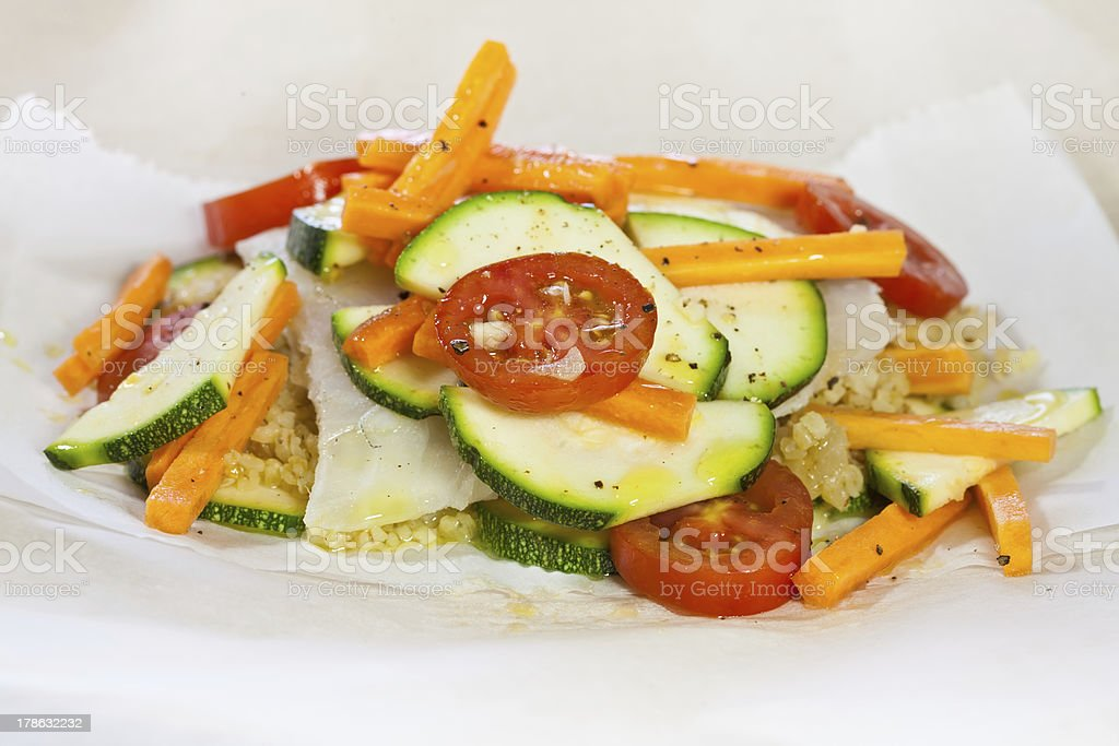 Papillote - hake fish in a paper ready to cook stock photo